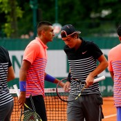 Nick Kyrgios (second from left) and Thanasi Kokkinakis (second from right) found themselves on opposite sides of the net in the first round of the men's doubles; Getty Images