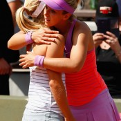 Sabine Lisicki (R) comforts Daria Gavrilova after the Aussie was forced to pull out of their second round match with an abdominal injury; Getty Images