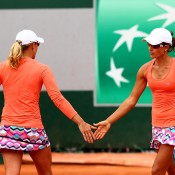 Anastasia Rodionova (L) and Arina Rodionova in doubles action at Roland Garros 2015; Getty Images