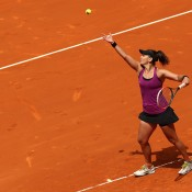 Casey Dellacqua in action during her first-round victory over Francesca Schiavone at the 2015 Mutua Madrid Open; Getty Images