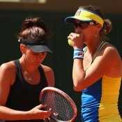Casey Dellacqua (L) and Yaroslava Shvedova in doubles action at Roland Garros 2015; Getty Images