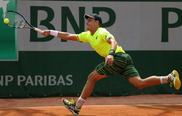 James Duckworth in action during his five-set first-round loss at Roland Garros 2015 to Italian qualifier Andrea Arnaboldi; Getty Images