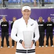 Sam Stosur holds the champion's trophy after winning the WTA Internationaux de Strasbourg; photo credit chryslenecaillaud.com