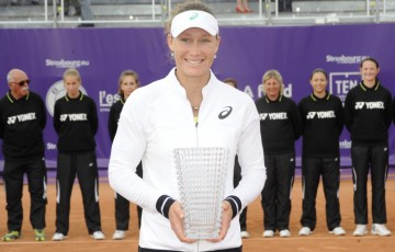 Sam Stosur holds the champion's trophy after winning the WTA Internationaux de Strasbourg; photo credit chryslenecaillaud.com