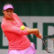 Sara Tomic of Australia plays a backhand in her rain-delayed girls' singles match against Aliona Bolsova Zadoinov of Spain at Roland Garros 2015; Getty Images