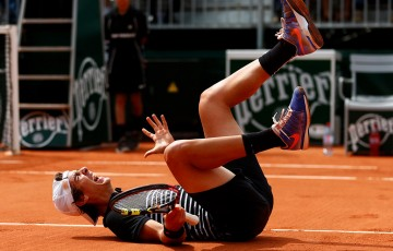 Thanasi Kokkinakis celebrates his five-set victory over fellow Aussie Bernard Tomic in the second round at Roland Garros; Getty Images