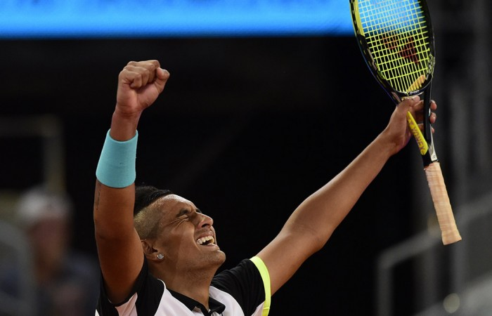 Nick Kyrgios celebrates his stunning victory over top seed Roger Federer in the second round at the 2015 Mutua Madrid Open; Getty Images