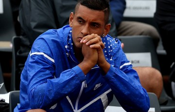 Nick Kyrgios watches the action at Roland Garros 2015; Getty Images