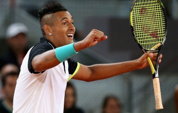 Nick Kyrgios celebrates his win over Roger Federer