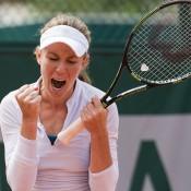 Olivia Rogowska celebrates her second round qualifying victory at Roland Garros; Elizabeth Xue Bai