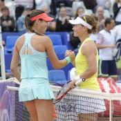 Sam Stosur (R) shakes hands with Ajla Tomljanovic  after winning their quarterfinal match at the WTA Internationaux de Strasbourg; photo credit chryslenecaillaud.com