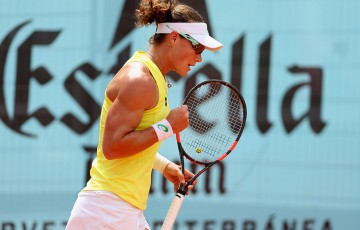 Sam Stosur celebrates a winning point during her second-round victory over Kaia Kanepi at the Mutua Madrid Open; Getty Images