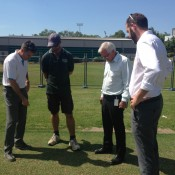 Todd Woodbridge, groundskeeper Shayne Ried, Minister for Sport and Recreation Gary Higgins and Tennis NT Manager Sam Gibson inspect the grass courts at Marrara.