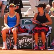 Casey Dellacqua (R) and Yaroslava Shvedova in action at Roland Garros; Getty Images