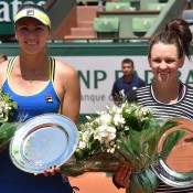 Casey Dellacqua (R) and Yaroslava Shvedova pose with their runners-up trophies after falling in the Roland Garros women's doubles final to Bethanie Mattek-Sands and Lucie Safarova; Getty Images