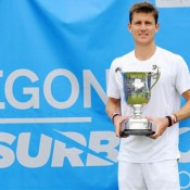 Matt Ebden poses with the winning trophy after claiming the title at the AEGON Surbiton Trophy in London, England.