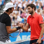 Thanasi Kokkinakis (L) shakes hands with Gilles Simon after losing their second-round match at the AEGON Championships at Queen's Club in London, England; Getty Images