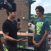 Thanasi Kokkinakis (R) chats to Fox Sports Australia