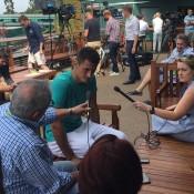 Bernard Tomic chats to the media