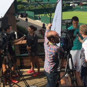 Casey Dellacqua (L) and Bernard Tomic (R) chat to the media