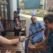 Thanasi Kokkinakis (R) chats to the media