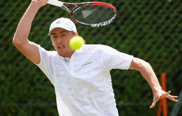 John Millman in action at Wimbledon qualifying; Getty Images