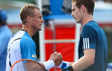 Andy Murray (R) and Lleyton Hewitt shake hands after their Kooyong Classic exhibition match in 2014; Getty Images