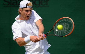 Luke Saville in action during Wimbledon qualifying at Roehampton, London; Getty Images