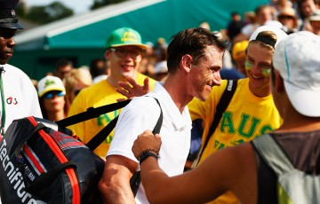 Qualifier John Millman is congratulated by Aussie fans after pushing Marcos Baghdatis to five sets in the second round; Getty Images