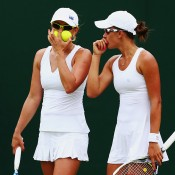 Anastasia (L) and Arina Rodionova in women's doubles action; Getty Images