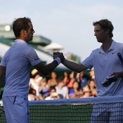 Luke Saville (R) shakes hands with Richard Gasquet after being eliminated by the 21st seed in the first round; Getty Images