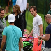 Thanasi Kokkinakis (facing away) during a practising with Andy Murray (in white) ahead of Wimbledon; Getty Images
