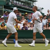 Thanasi Kokkinakis (L) and Lleyton Hewitt scored a dramatic five-set victory in the first round of the men's doubles; Getty Images