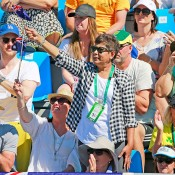 Nill Kyrgios (standing) supports Hewitt and Groth during the doubles rubber of Australia's Davis Cup quarterfinal tie in Darwin against Kazakhstan; Getty Images