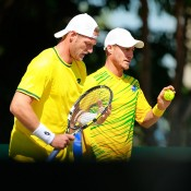 Lleyton Hewitt (R) and Sam Groth in doubles action for Australia in the Davis Cup quarterfinal against Kazakhstan in Darwin; Getty Images