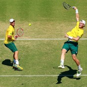 Lleyton Hewitt (L) and Sam Groth in doubles action for Australia in the Davis Cup quarterfinal against Kazakhstan in Darwin; Getty Images