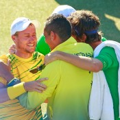 Lleyton Hewitt (L) celebrates his victory over Aleksandr Nedovyesov with teammates following the decisive fifth rubber of the Australia v Kazakhstan Davis Cup World Group quarterfinal in Darwin; Getty Images