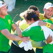 Lleyton Hewitt (R) celebrates his victory over Aleksandr Nedovyesov with teammates following the decisive fifth rubber of the Australia v Kazakhstan Davis Cup World Group quarterfinal in Darwin; Getty Images