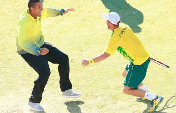 Lleyton Hewitt (R) celebrates his victory over Aleksandr Nedovyesov with Nick Kyrgios following the decisive fifth rubber of the Australia v Kazakhstan Davis Cup World Group quarterfinal in Darwin; Getty Images