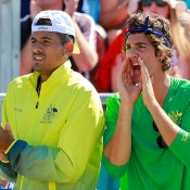 Nick Kyrgios (L) and Thanasi Kokkinakis show their support for Sam Groth during the reverse singles of the Australia v Kazakhstan Davis Cup tie in Darwin; Getty Images