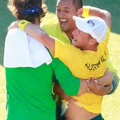 Lleyton Hewitt (R) celebrates his victory over Aleksandr Nedovyesov with Nick Kyrgios (centre) and Thanasi Kokkinakis following the decisive fifth rubber of the Australia v Kazakhstan Davis Cup World Group quarterfinal in Darwin; Getty Images