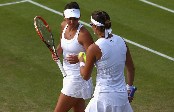 Casey Dellacqua (L) and Yaroslava Shvedova in action during the women's doubles quarterfinals at Wimbledon; Getty Images