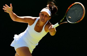 Casey Dellacqua in action during her first round victory at the 2015 Wimbledon Championships; Getty Images
