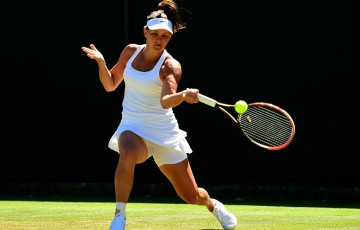 Casey Dellacqua in action during her first-round win over Tamira Paszek at Wimbledon; Getty Images