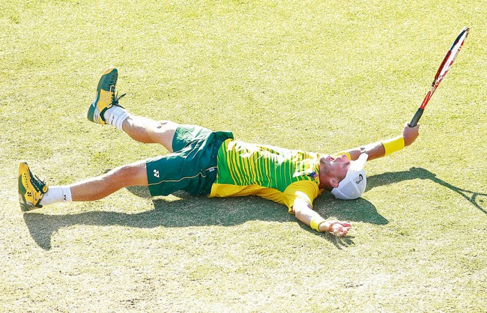 Lleyton Hewitt celebrates his victory over Aleksandr Nedovyesov in the decisive fifth rubber of the Australia v Kazakhstan Davis Cup World Group quarterfinal in Darwin; Getty Images