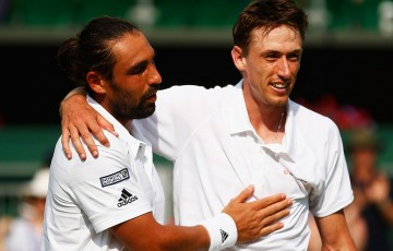 Marco Baghdatis (L) embraces Aussie John Millman after winning their second-round match at the 2015 Wimbledon Championships; Getty Images