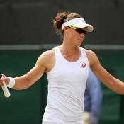 Sam Stosur reacts during her straight-sets third-round loss to Coco Vandeweghe at Wimbledon; Getty Images