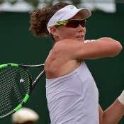 Sam Stosur plays a backhand on her way to a second-round victory over Urszula Radwanska at the 2015 Wimbledon Championships; Getty Images