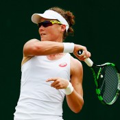 Sam Stosur plays a forehand on her way to a second-round victory over Urszula Radwanska at the 2015 Wimbledon Championships; Getty Images