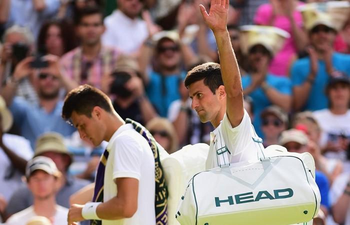 Bernard Tomic (L) and Novak Djokovic exit Centre Court after Djokovic won their third-round match at Wimbledon; Getty Images